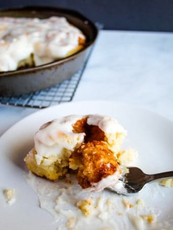 gluten free cinnamon rolls on a white plate