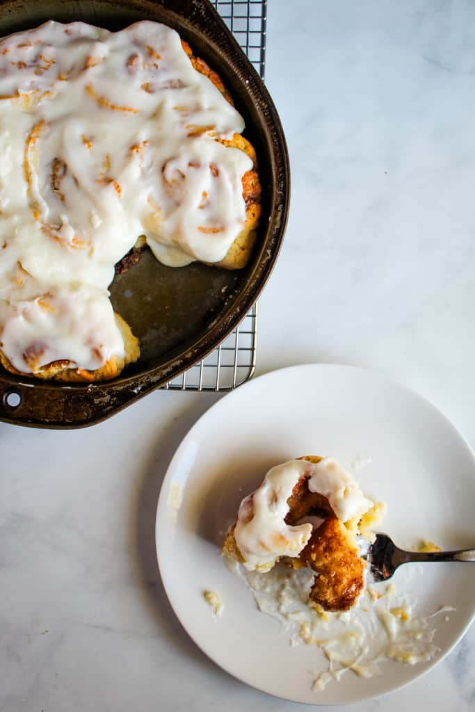 gluten free cinnamon rolls portioned on a white plate