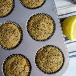 gluten free lemon poppy seed muffins baked in a muffin pan