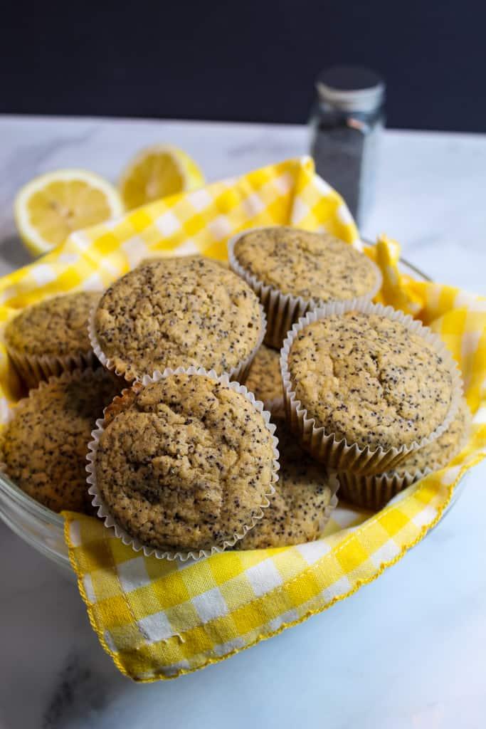 gluten free lemon poppy seed muffins in a basket