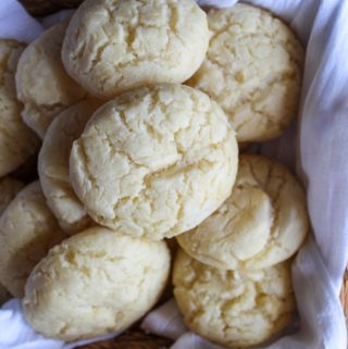 gluten free potato rolls in a basket with a white cloth.
