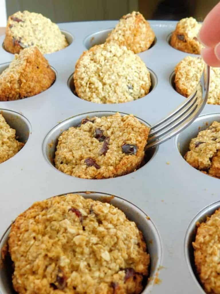 gluten fre dairy free cranberry orange muffins in the pan