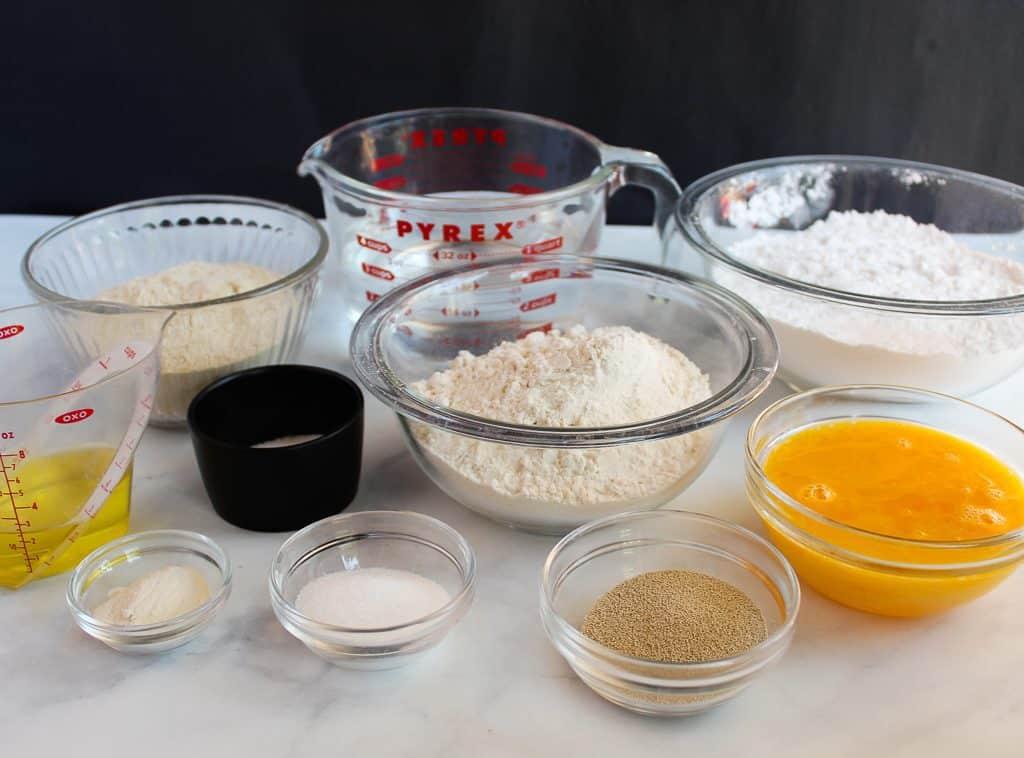 gluten free artisan bread ingredients on a white counter.