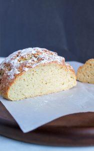 gluten free artisan bread interior on a wooden board.