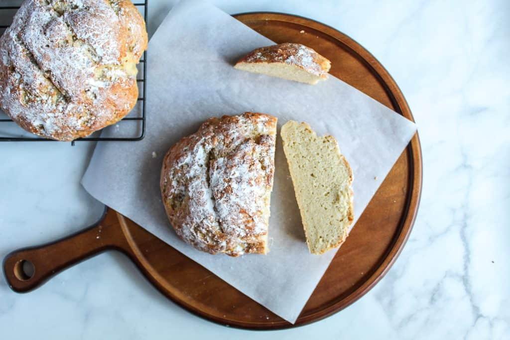 gluten free artisan bread sliced on a wooden board