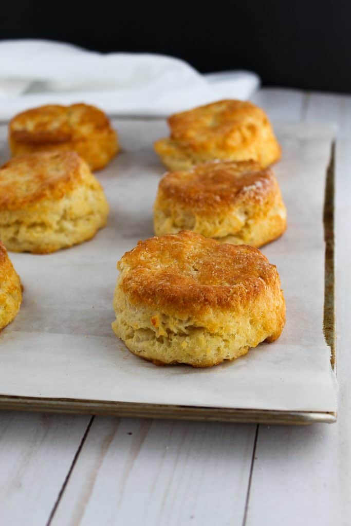 gluten free biscuits sitting on a baking sheet.