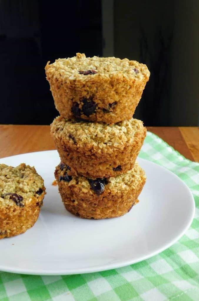 gluten free dairy free cranberry orange muffins stacked