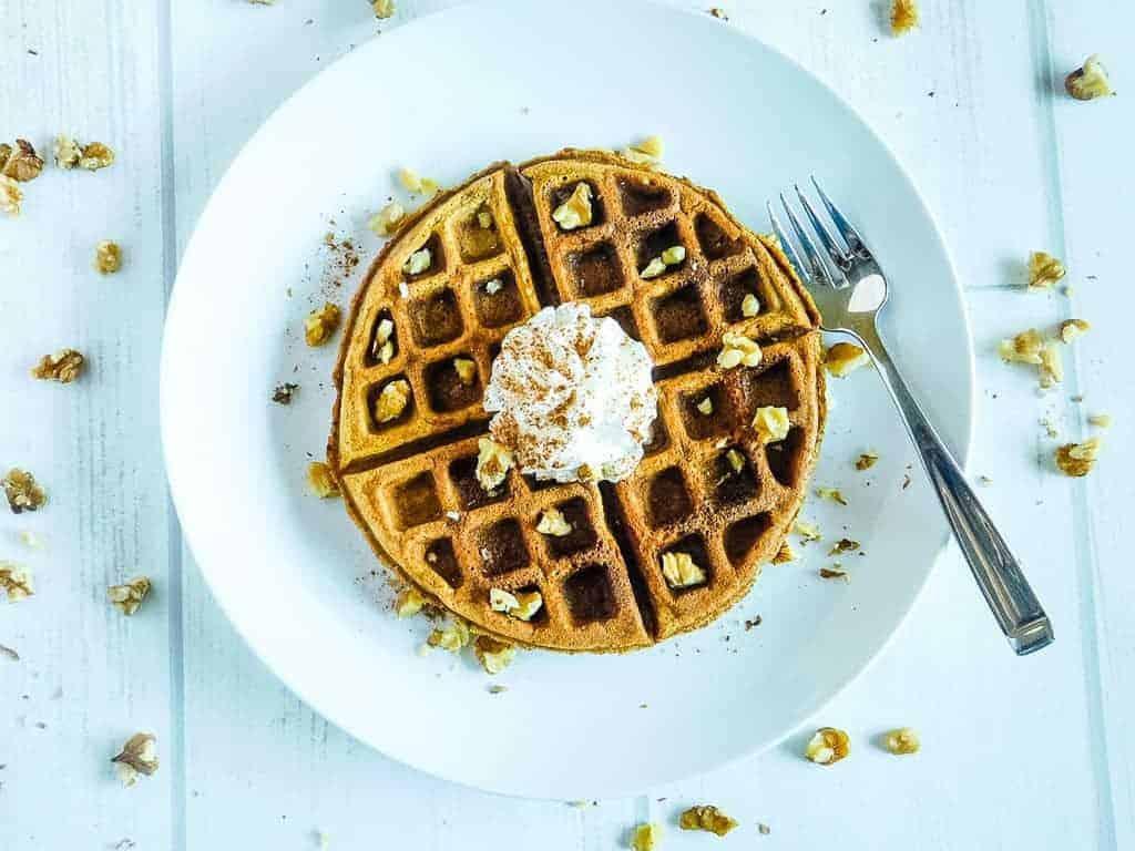 gluten free pumpkin waffle sitting on a white plate