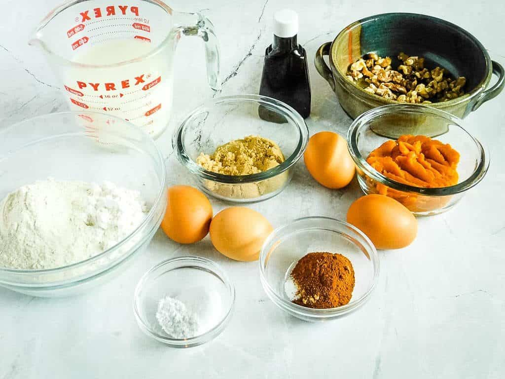 ingredients for gluten free pumpkin waffles on a white countertop