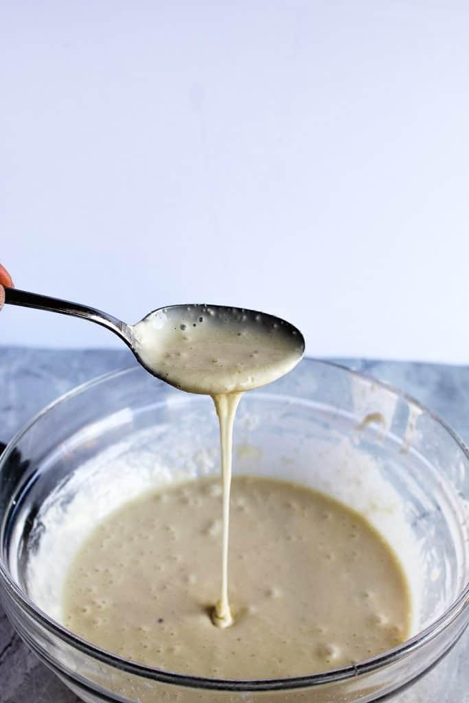 Gluten free pita bread batter on a spoon
