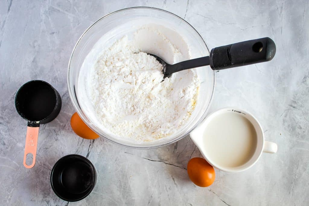 Ingredients for gluten free pita bread on a white counter