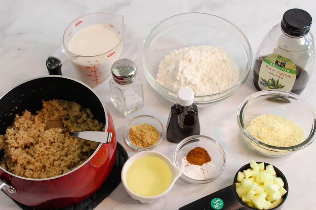 apple quinoa muffins ingredients on a white counter