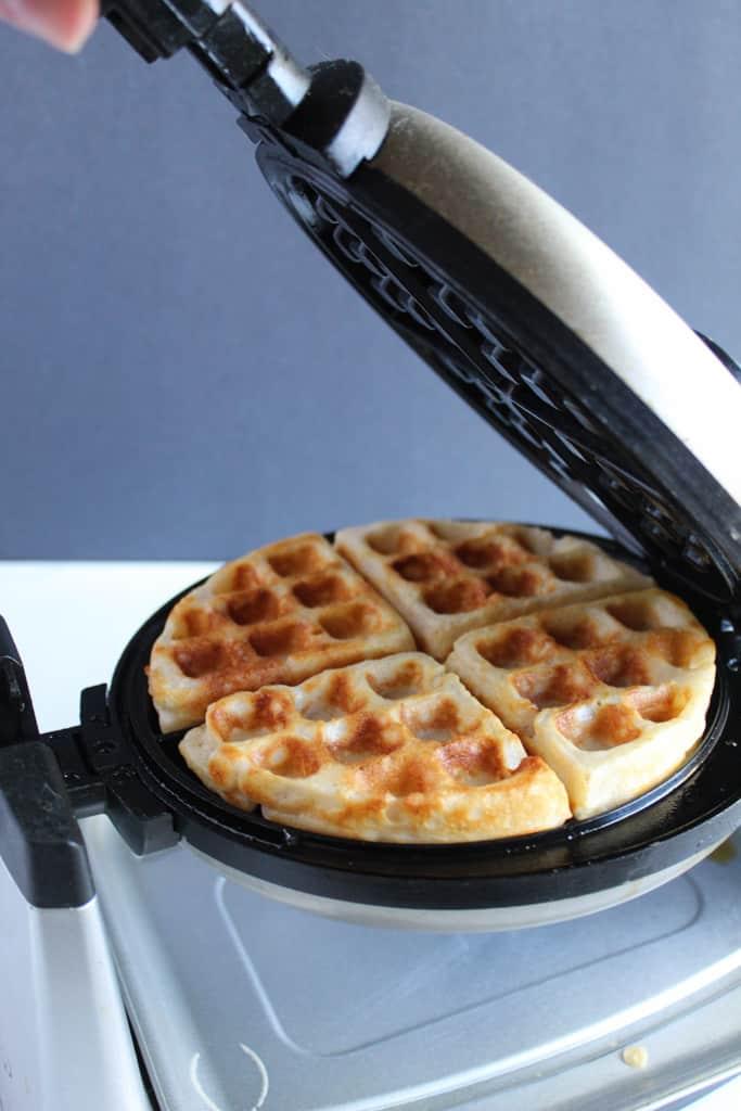 gluten free belgian waffles cooking in a waffle maker