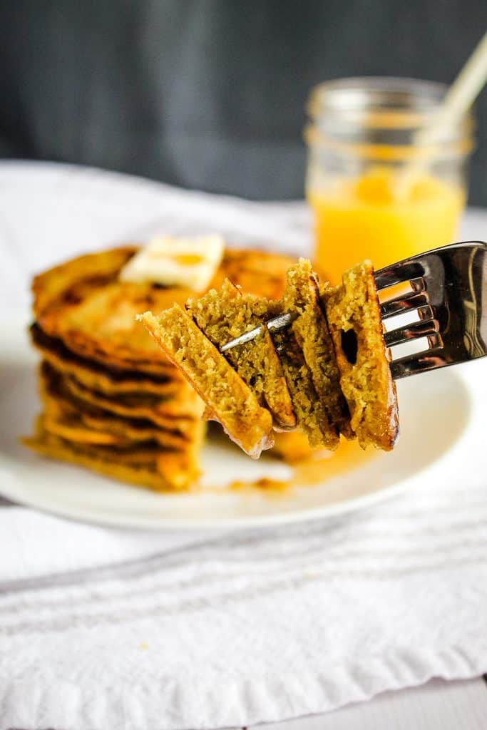 gluten free buckwheat pancakes bite on a fork