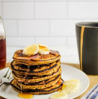 side shot of stack of pancakes