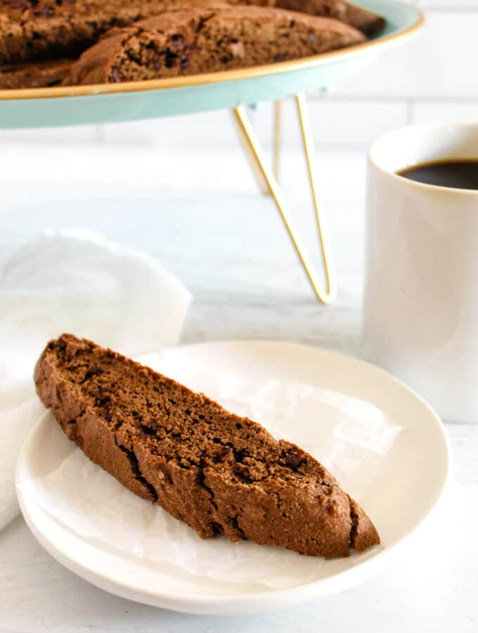 side shot of biscotti on a white plate