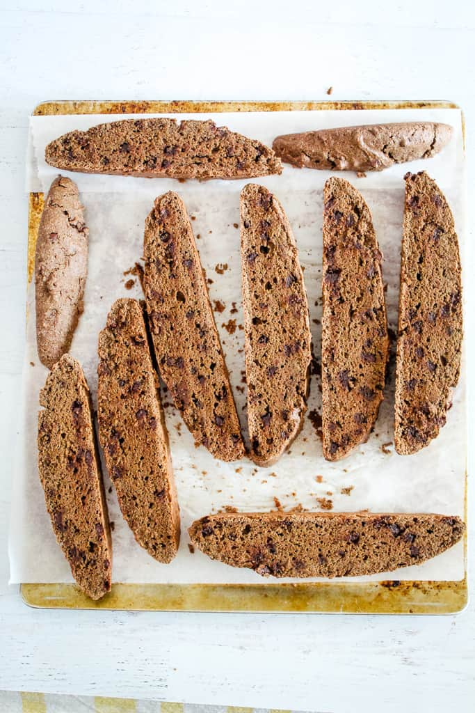 overhead shot of cut biscotti on a pan
