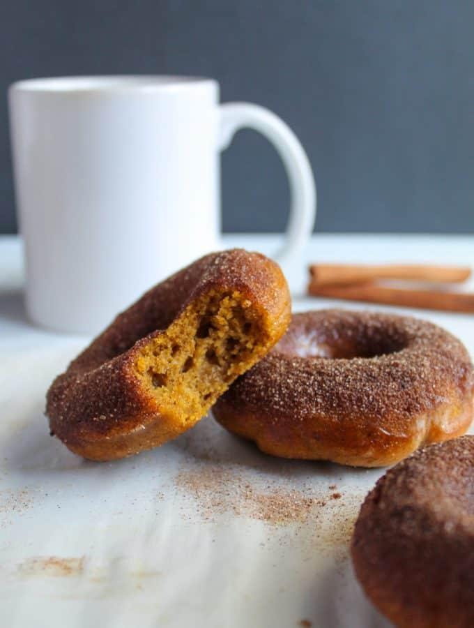 gluten free pumpkin donuts sitting on a white counter