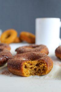 gluten free pumpkin donuts with a bite