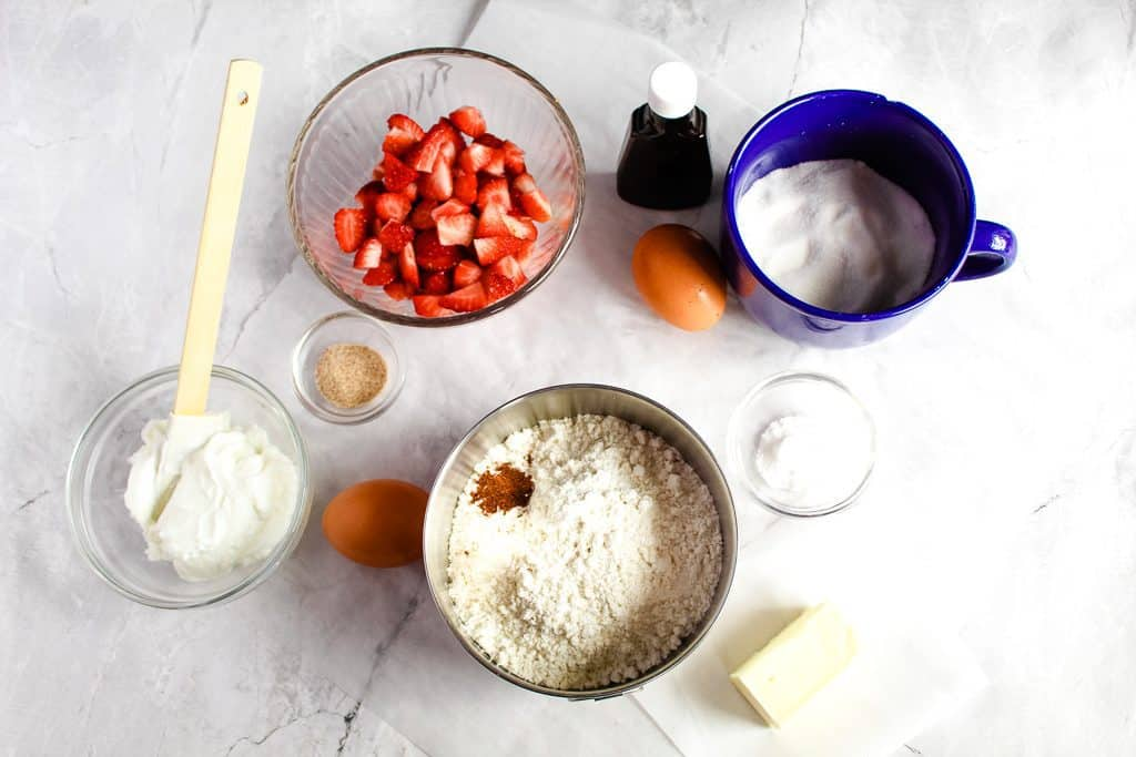 Gluten free strawberry muffins ingredients on a white countertop