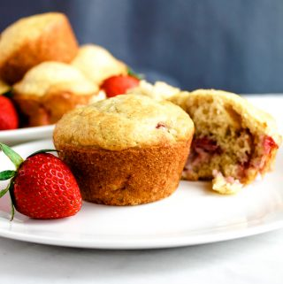 Gluten free strawberry muffins on a white plate