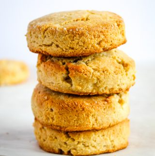 almond flour biscuits stacked on a white counter
