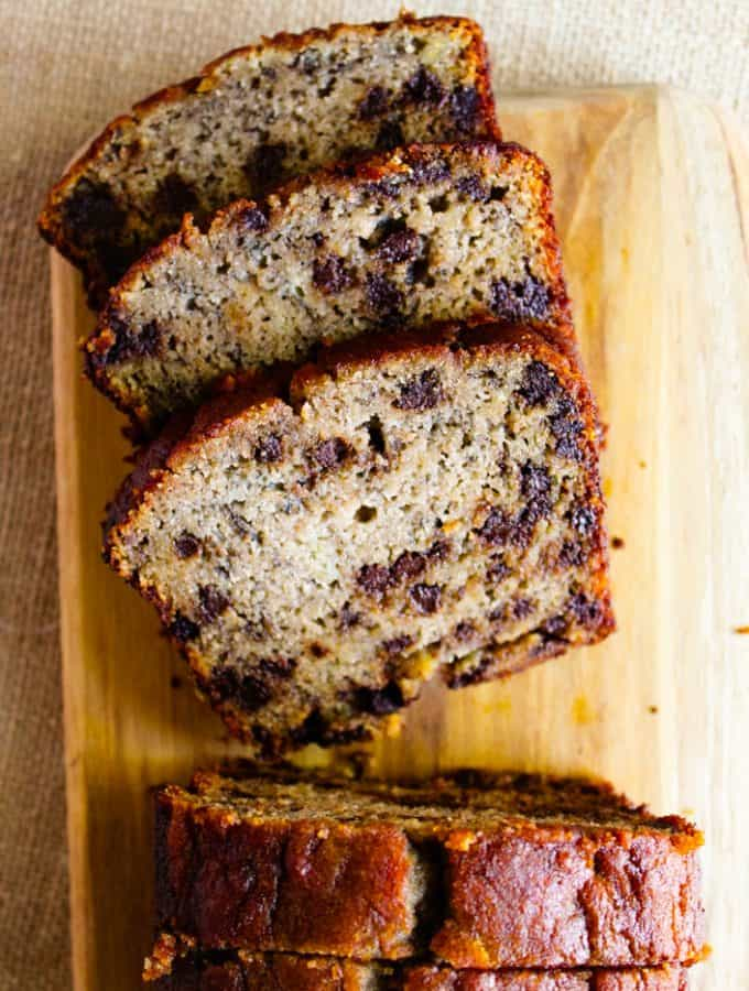 gluten free chocolate chip banana bread slices on a cutting board