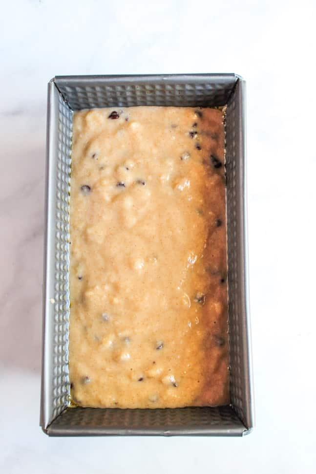 gluten free chocolate chip banana bread batter in a baking pan