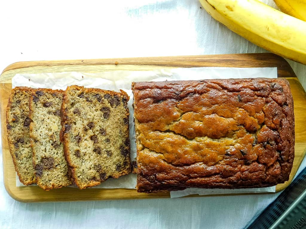 gluten free chocolate chip banana bread sliced on a cutting board