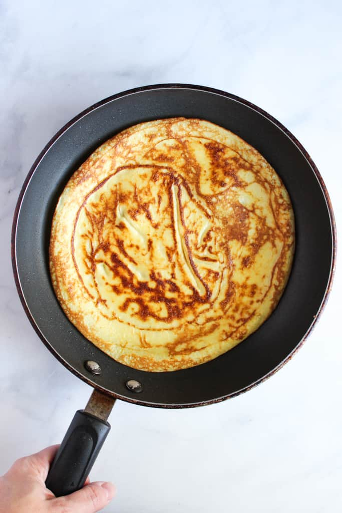gluten free crepes cooking in a skillet