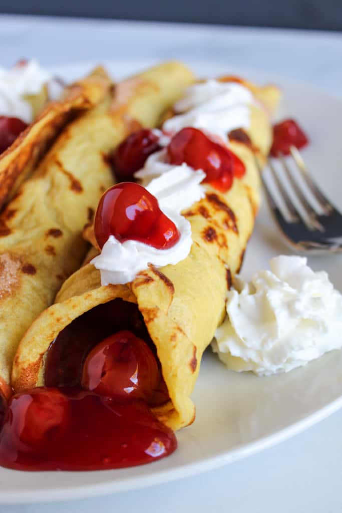 gluten free crepes served on a white plate