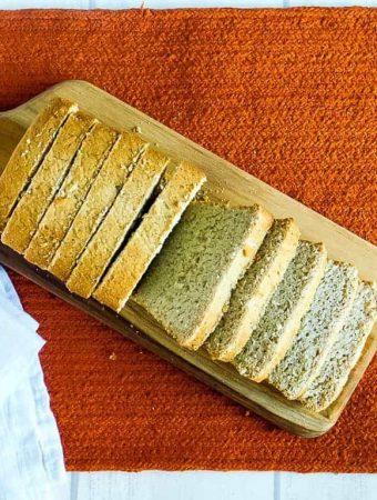 gluten free vegan sandwich bread on a cutting board on an orange towel
