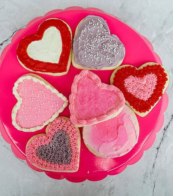 decorated gluten free valentine cookies on a pink platter