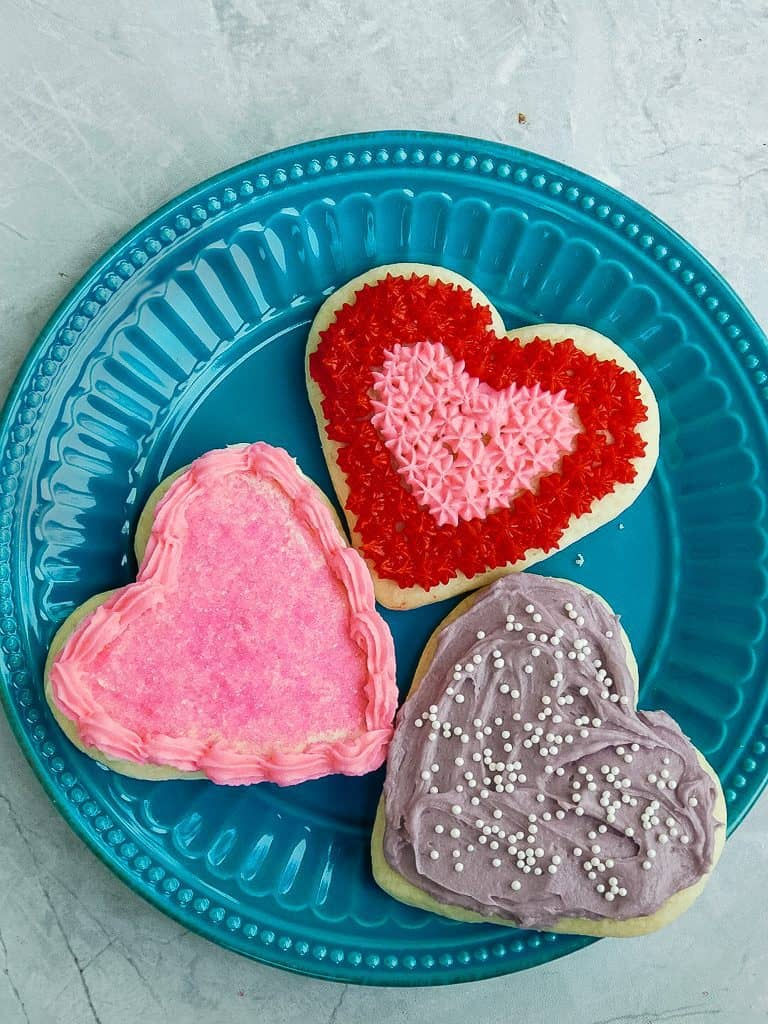 valentine cookies on a turquoise plate