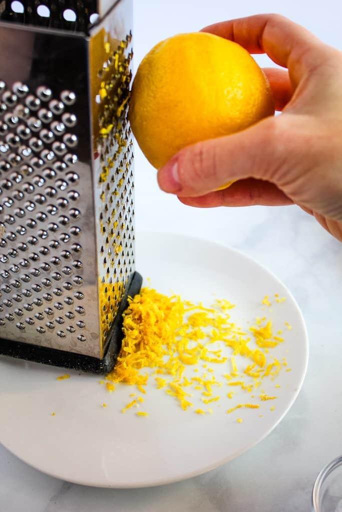 gluten free lemon blueberry scones lemon zest on a grater