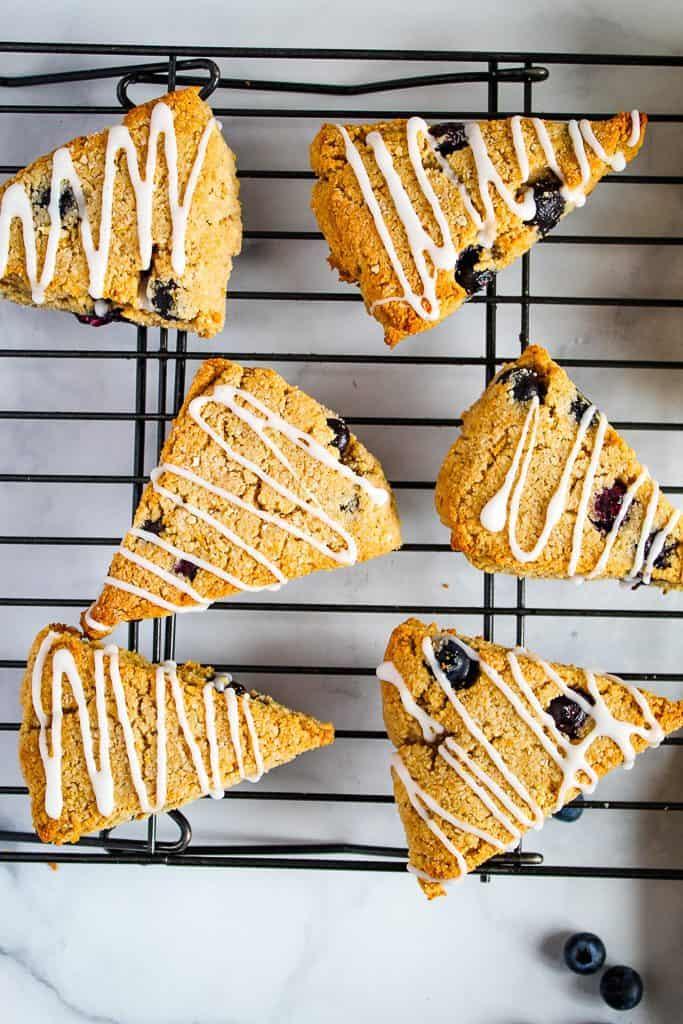 gluten free lemon blueberry scones on a wire rack