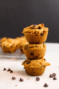 gluten free peanut butter muffins stacked on top of each other