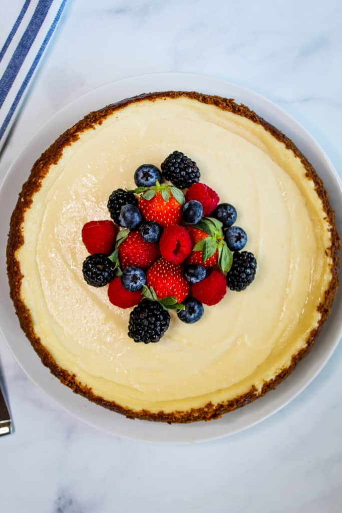 gluten free dairy free cheesecake served with berries on a white plate