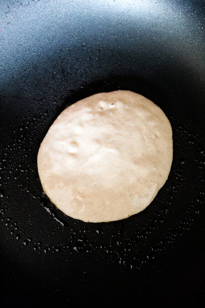 rice flour pancakes cooking in a skillet