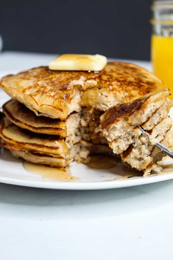 rice flour pancakes stacked on a white plate