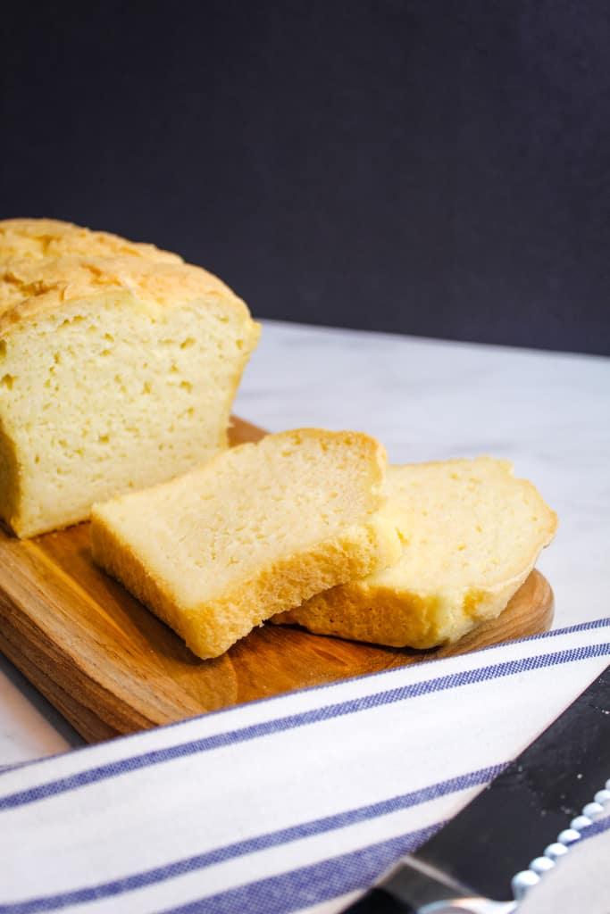 gluten free potato bread sliced on a cutting board