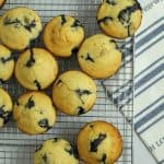 gluten free banana blueberry muffins all sitting on a wire rack
