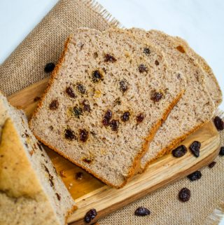 gluten free bread machine cinnamon raisin bread on a wooden board