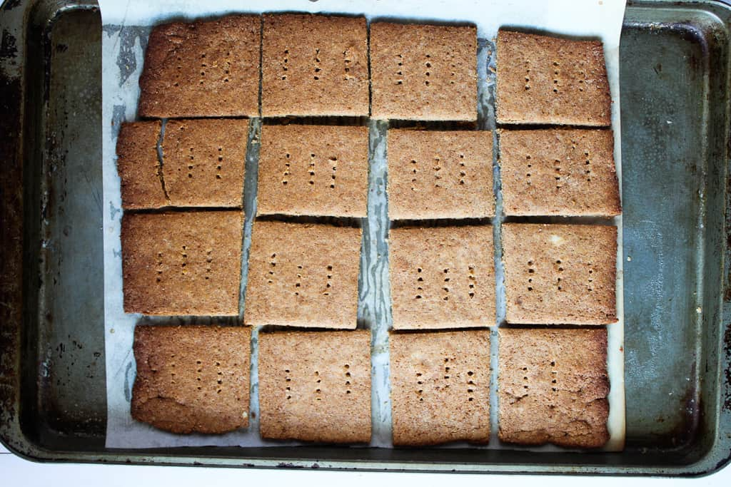 low carb gluten free graham crackers baked on a baking pan.