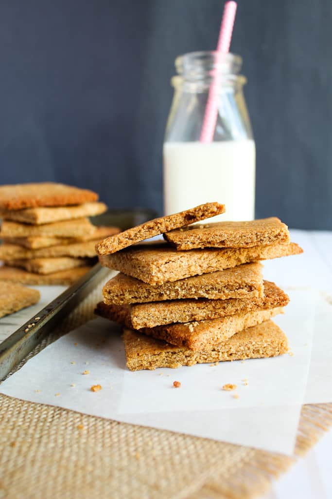 lowcarb gluten free graham crackers stacked on a white parchment.
