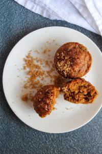 vegan pumpkin muffins on a white plate.