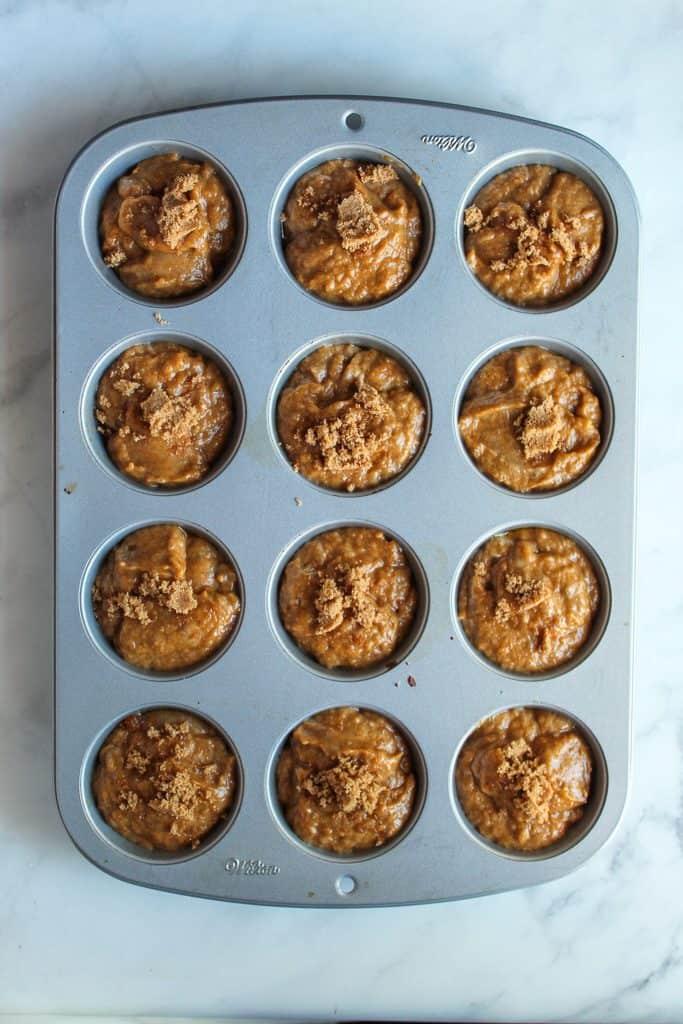 vegan pumpkin muffins batter in the pan.