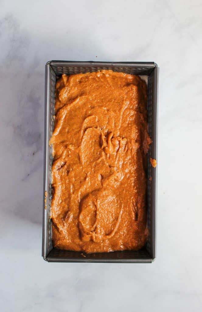 gluten free pumpkin bread batter in a baking pan.