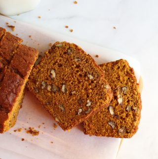 gluten free pumpkin bread thick slices on a counter.