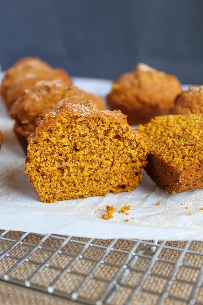 gluten free pumpkin muffins on a wire rack.